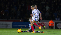 Jason McCarthy of Wycombe Wanderers tackles Kyle Bennett of Portsmouth during the Sky Bet League 2 match between Wycombe Wanderers and Portsmouth at Adams Park, High Wycombe, England on 28 November 2015. Photo by Andy Rowland.