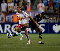 Jermaine Jenas (8) of Tottenham fights for the ball with Joel Lindpere (20) of the New York Red Bulls during the Barclays New York Challenge at Red Bull Arena in Harrison, NY.  Tottenham defeated the New York Red Bulls, 2-1.