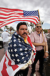 Santos Perez, left, wears an American flag at a rally and march in San Jose, Calif., Tuesday, May 1, 2007 during an immigration demonstration. Demonstrators demanding a path to citizenship for an estimated 12 million illegal immigrants rallied around the nation Tuesday, hoping to spur Congress to act before the looming presidential primaries take over the political landscape. (AP Photo/Paul Sakuma)