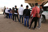 El Paso, Tx - NEWS:   Ride along with Customs and Border Protection agents, El Paso, Tx, Monday, April 29, 2019.<br /> <br /> <br /> PICTURED:  A group of 18 migrants - including 2 children and a a teenager - seeking asylum in the USA turn themselves in to border patrol agents near the border fence.  This area is called 'Nicholson's Crossing' by border patrol agents.  <br /> <br /> <br /> (Angel Chevrestt, 646.314.3206)