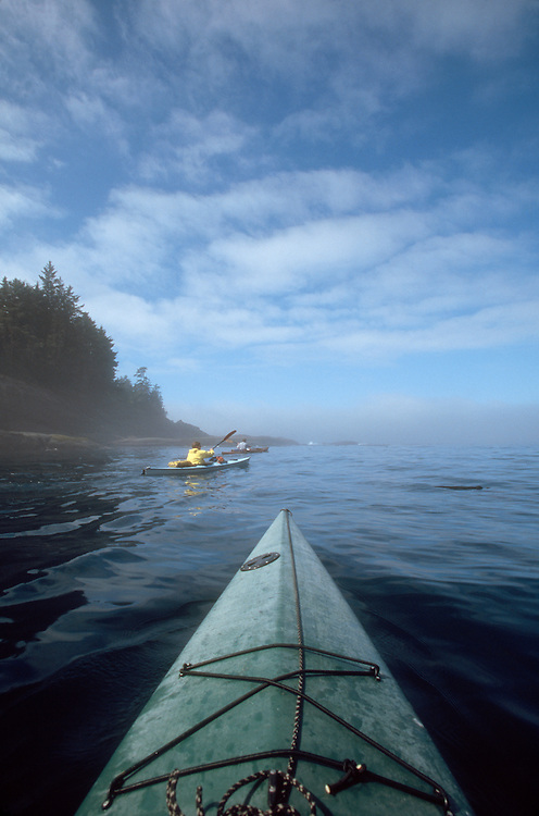 Sea Kayakers, approach Cape Flattery, Strait of Juan de Fuca,.Washington State, Pacific Northwest, Pacific Ocean,.