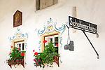 Austria, Tyrol, Wildschoenau: high valley at Kithbuehel Alps, district Oberau, bootmaker's guild sign | Oesterreich, Tirol, Wildschoenau: Hochtal in den Kitzbueheler Alpen bei Woergl, Ortsteil Oberau, Zunftschild Schuhmacherei