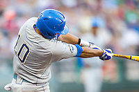 UCLA shortstop Pat Valaika (10) swings the bat against the North Carolina State Wolfpack during Game 8 of the 2013 Men's College World Series on June 18, 2013 at TD Ameritrade Park in Omaha, Nebraska. The Bruins defeated the Wolfpack 2-1, eliminating North Carolina State from the tournament. (Andrew Woolley/Four Seam Images)