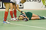 Berlin, Germany, February 01: Mirja Zoeller #27 of HTC Uhlenhorst Muehlheim lies on the pitch during the 1. Bundesliga Damen Hallensaison 2014/15 final hockey match between Duesseldorfer HC (white) and HTC Uhlenhorst Muehlheim (green) on February 1, 2015 at the Final Four tournament at Max-Schmeling-Halle in Berlin, Germany. Final score 4-1 (1-0). (Photo by Dirk Markgraf / www.265-images.com) *** Local caption ***