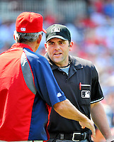 10 July 2011: Home Plate Umpire Brian Knight has words with Davey Johnson of the Washington Nationals at Nationals Park in Washington, District of Columbia. The Nationals shut out the visiting Rockies 2-0 salvaging the last game their 3-game series at home prior to the All-Star break. Mandatory Credit: Ed Wolfstein Photo