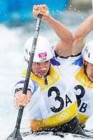02 AUG 2012 - CHESHUNT, GBR - Tim Baillie (GBR) (left) and Etienne Stott (hidden, right) of Great Britain make their final run in the men's Canoe Double (C2) during the London 2012 Olympic Games final at Lee Valley White Water Centre, Cheshunt, Great Britain .(PHOTO (C) 2012 NIGEL FARROW)