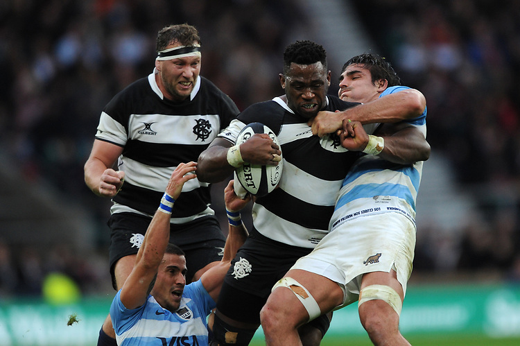 Siya Kolisi of Barbarians (Stormers & South Africa)  struggles against Pablo Matera (c) of Argentina during the Killik Cup match between the Barbarians and Argentina at Twickenham Stadium on Saturday 1st December 2018 (Photo by Rob Munro/Stewart Communications)