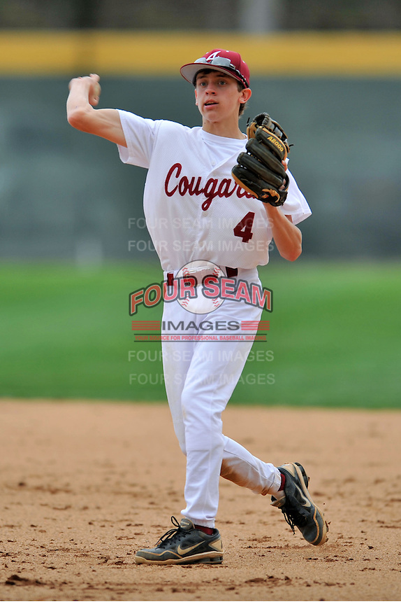 Asheville Cougars second baseman Sam Weidie #4 throws to first during a game against the T.C. Roberson Rams  at Asheville High on April 15, 2013 in Asheville, North Carolina. The Rams won 4-1. (Tony Farlow/Four Seam Images).