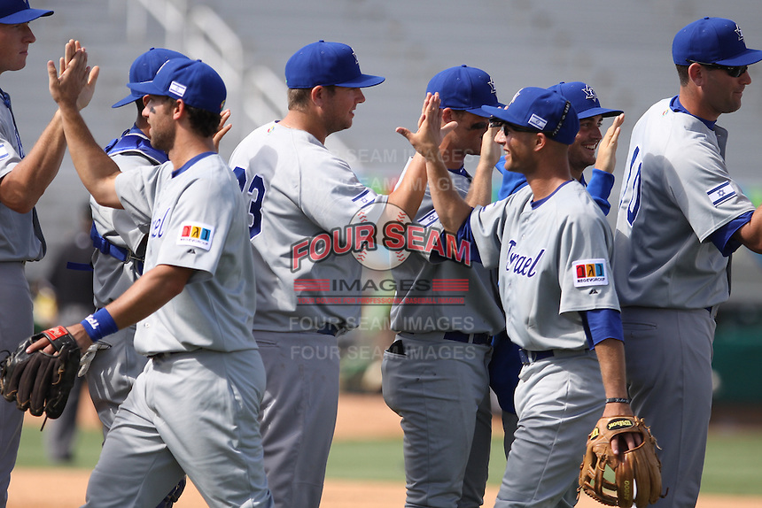Team Israel celebrates their win over Team Spain during the World Baseball Classic preliminary round at Roger Dean Stadium on September 21, 2012 in Jupiter, Florida. Team Israel defeated Team Spain 4-2. (Stacy Jo Grant/Four Seam Images)