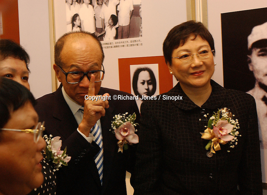 """Deng's three daughters - Deng Lin, Deng Nan and Deng Rong at the opening ceremony of """"Giant of the Century"""" - an exhibition to commemorate the 100th Anniversary of the Birth of Deng Xiaoping in Hong Kong. The exhibition aims at introducing Deng's life to the people of Hong Kong.<br /> 26-AUG-04"""