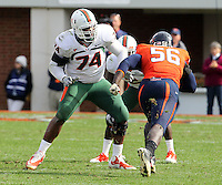 Oct 30, 2010; Charlottesville, VA, USA;   Miami Hurricanes offensive linesman Orlando Franklin (74) prepares to block Virginia Cavaliers defensive end Cam Johnson (56) during the game at Scott Stadium. Virginia won 24-19. Mandatory Credit: Andrew Shurtleff