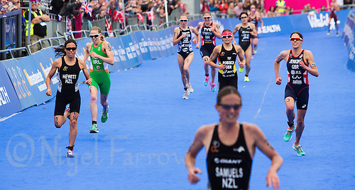31 MAY 2014 - LONDON, GBR - Helen Jenkins (GBR) (WAL) (right) of Great Britain and Wales sprints for the finish line during the elite women's 2014 ITU World Triathlon Series round in Hyde Park, London, Great Britain (PHOTO COPYRIGHT © 2014 NIGEL FARROW, ALL RIGHTS RESERVED)