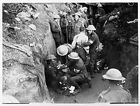 With the Canadians in the great battle<br /> Description<br /> <br /> The Canadians played a great part in the battle of the 15th Sept. [1916] storming the village of Courcelette and taking many prisoners. The picture shows the first aid to wounded in a trench<br /> <br /> <br /> 15 september 1916<br /> Location<br /> <br /> Courcelette, France