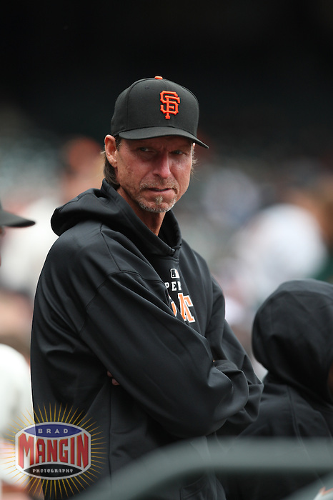SAN FRANCISCO - MAY 3:  Randy Johnson #51 of the San Francisco Giants stands in the dugout against the Colorado Rockies during the game at AT&T Park on May 3, 2009 in San Francisco, California. Photo by Brad Mangin