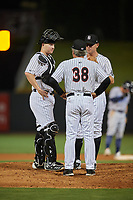 Birmingham Barons relief pitcher Brad Goldberg (8) in a mound visit with catcher Zack Collins (24) and pitching coach Richard Dotson (38) during a game against the Pensacola Blue Wahoos on May 8, 2018 at Regions FIeld in Birmingham, Alabama.  Birmingham defeated Pensacola 5-2.  (Mike Janes/Four Seam Images)