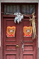 Huanggang, Guizhou, China.  A Dong Ethnic Village.  Door Decorations Celebrating a Recent Wedding, Warding Off Evil Spirits.