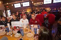 NWA Democrat-Gazette/JASON IVESTER<br /> Arkansas soccer players watch the selection show on Monday, Nov. 7, 2016, at Sassy's Barbeque & Grille in Fayetteville. The Razorbacks will host Memphis on Friday in the first round of the NCAA tournament.