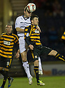 Raith Rovers' Laurie Ellis gets above Alloa's Kevin Cawley.