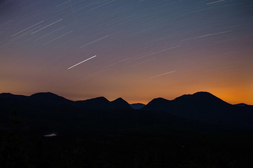 Stars whirl overhead in this single capture time-lapse image of Carrigain Notch.