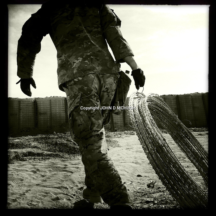 1 Platoon, Delta Co, 1-66, 4th Infantry Division, reinforce a checkpoint in Arghandab Valley, Kandahar, 29 April 2011. (John D McHugh)