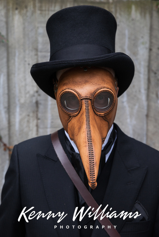 Steampunk Man in Black Suit & Leather Penguin Mask, Emerald City Comicon 2017, Seattle, WA, USA.