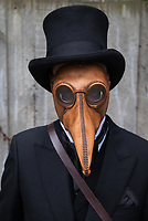 Steampunk Man in Black Suit & Leather Penguin Mask, Emerald City Comicon 2017, Seattle, WA, USA.