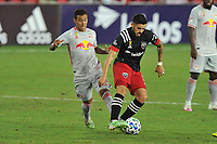 WASHINGTON, DC - SEPTEMBER 12: Junior Moreno #5 of D.C. United battles for the ball with Kaku #10 of New York Red Bulls during a game between New York Red Bulls and D.C. United at Audi Field on September 12, 2020 in Washington, DC.