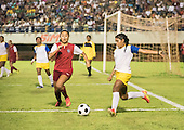 Two women compete for the ball during the final of the women's football, between the local Xerente tribe and the Native American team from Canada at the International Indigenous Games in the city of Palmas, Tocantins State, Brazil. The USA won on a penalty shoot-out after a 0-0 match. Photo © Sue Cunningham, pictures@scphotographic.com 30th October 2015