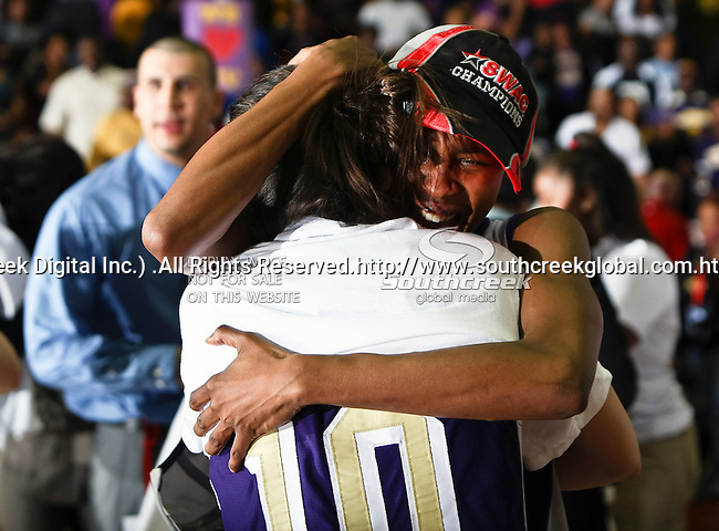 Prairie View A&M Lady Panthers guard Dominique Smith (1) and Prairie View A&M Lady Panthers guard Siarra Soliz (10) get emotional after winning the SWAC Tournament Championship game between the Prairie View A&M Lady Panthers and the Southern University Jaguars at the Special Events Center in Garland, Texas. Prairie View defeats  Southern 48 to 44