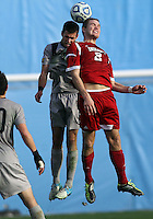 HOOVER, AL - DECEMBER 09, 2012: Eriq Zavaleta (2) of Indiana University goes up for a header against Tommy Muller (8) of Georgetown University during the NCAA 2012 Men's College Cup championship, at Regions Park, in Hoover , AL, on Sunday, December 09, 2012.