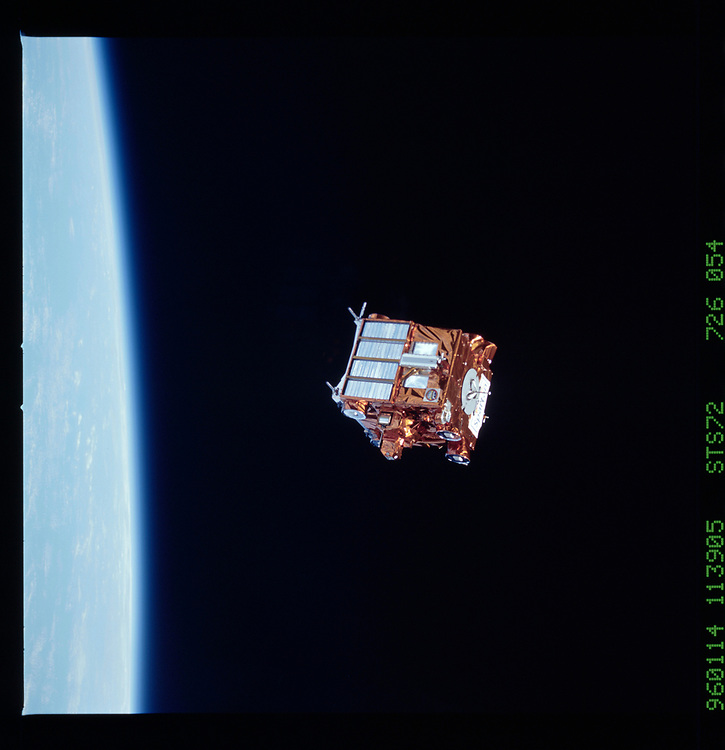 John Angerson. STS-72 Book.<br /> Public Domain Image.<br /> NASA images Courtesy National Archives - Record Group number: 255-STS-STS072<br /> Description: Deploy of the Office of Aeronautics and Space Technology-Flyer (OAST-Flyer) by the remote manipulator system (RMS). Endeavour moves away from OAST-Flyer which gradually shrinks in size, backdropped by the earth.<br /> <br /> Subject Terms: STS-72, ENDEAVOUR (ORBITER), SPARTAN SATELLITES, EARTH OBSERVATIONS (FROM SPACE), REMOTE MANIPULATOR SYSTEM, EARTH LIMB<br /> <br /> Date Taken: 1/14/1996<br /> <br /> Categories: Payloads<br /> <br /> Interior_Exterior: Exterior<br /> <br /> Ground_Orbit: On-orbit<br /> <br /> Original: Film - 70MM CT<br /> <br /> Preservation File Format: TIFF<br /> <br /> feat: NON-EARTHOBS<br /> <br /> nlat: -12.1<br /> <br /> nlon: -13.1<br /> <br /> azi: 118<br /> <br /> alt: 165<br /> <br /> elev: 68