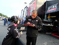 May 18, 2014; Commerce, GA, USA; NHRA top fuel driver J.R. Todd fsigns autographs in the pits during the Southern Nationals at Atlanta Dragway. Mandatory Credit: Mark J. Rebilas-USA TODAY Sports