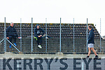 'Hows the going lads' Supporters climbed walls to catch a glimpse at the Dr Crokes v Templenoe SFC clash in Fitzgerald Stadium on Friday evening