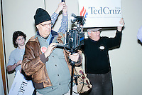 A photographer with a vintage camera gets ready before Texas senator and Republican presidential candidate Ted Cruz speaks at a town hall at The Alpine Grove banquet center in Hollis, New Hampshire.