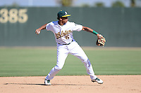 Oakland Athletics shortstop Yairo Munoz (5) during an instructional league game against the San Francisco Giants on September 27, 2013 at Papago Park Baseball Complex in Phoenix, Arizona.  (Mike Janes/Four Seam Images)