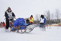 Jonathon Biggerstaff and dog team leaves the start line of the 2013 Junior Iditarod on Knik Lake.  Knik Alaska..Photo by Jeff Schultz/IditarodPhotos.com   Reproduction prohibited without written permission