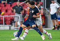 WASHINGTON, DC - SEPTEMBER 6: Virginia forward Leo Alfonso (7) blocks Maryland forward Justin Gielen (9) during a game between University of Virginia and University of Maryland at Audi Field on September 6, 2021 in Washington, DC.
