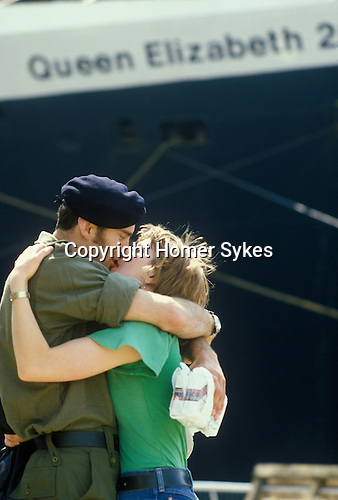 Southampton, Hampshire. 1982<br /> On Wednesday 12 May the QE2 set sail from Southampton Dock for the Falklands War. The ship had been turned into a troop carrier. A British soldier kisses his farewell.