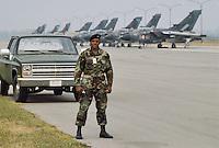 - Italian Air Force, alignment of strike aircraft Tornado IDS of 6th Wing and  US security guard on Ghedi air base....- Aeronautica Militare Italiana, linea di volo di aerei da attaccoTornado IDS del 6° Stormo e guardia di sicurezza USA sulla base aerea di Ghedi......