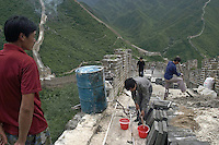Workers repair the Huanghuacheng section of the Great Wall in suburban Beijing, China. Beijing began repairing a 12.4 kilometer section of the Ming-era Great Wall at cost of 12 million yuan(US$1.45 million) from this March..16-JUL-04