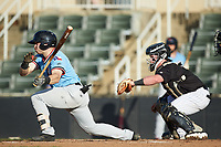Matt Whatley (19) of the Hickory Crawdads follows through on his swing against the Kannapolis Intimidators at Kannapolis Intimidators Stadium on May 6, 2019 in Kannapolis, North Carolina. The Crawdads defeated the Intimidators 2-1 in game one of a double-header. (Brian Westerholt/Four Seam Images)