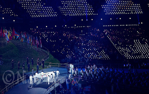 """27 JUL 2012 - LONDON, GBR - The Olympic Flag is carried around the arena during the """"Let the Games Begin"""" section of the Opening Ceremony of the London 2012 Olympic Games in the Olympic Stadium in the Olympic Park, Stratford, London, Great Britain .(PHOTO (C) 2012 NIGEL FARROW)"""