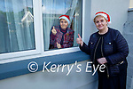 Mairead Hanlon from the Ard Chúram Day Care Centre in Listowel paying a visit to 81 year old Dolores Carroll to wish her a Happy Christmas