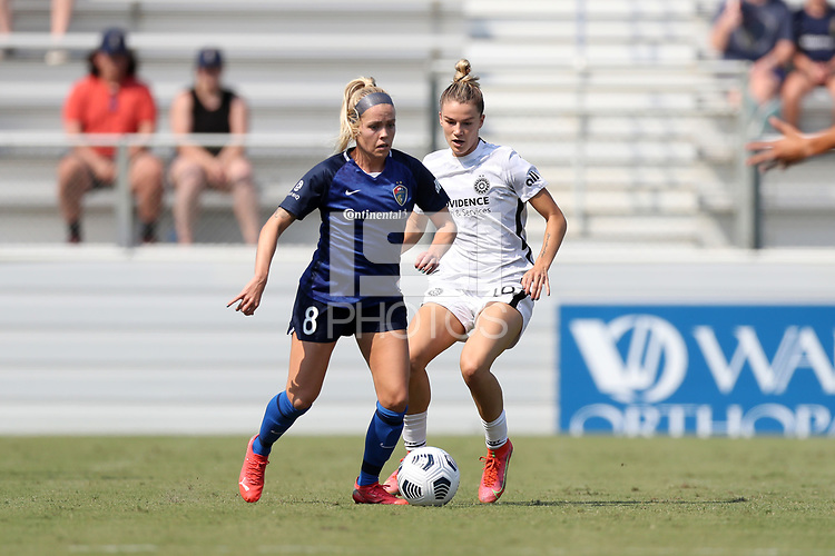 CARY, NC - SEPTEMBER 12: Denise O'Sullivan #8 of the North Carolina Courage is defended by Christen Westphal #18 of the Portland Thorns FC during a game between Portland Thorns FC and North Carolina Courage at Sahlen's Stadium at WakeMed Soccer Park on September 12, 2021 in Cary, North Carolina.