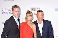 BRENTWOOD, CA - JUNE 11: (L-R) Actors Eric Dane, Rebecca Gayheart-Dane and Justin Chambers arrive at the 15th Annual Chrysalis Butterfly Ball at a private residence on June 11, 2016 in Brentwood, California.