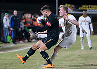COLLEGE PARK, MD - NOVEMBER 21: Josh Plimpton #7 of Iona clashes with Johannes Bergman #5 of Maryland during a game between Iona College and University of Maryland at Ludwig Field on November 21, 2019 in College Park, Maryland.