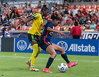 HOUSTON, TX - JUNE 13: Deneisha Blackwood #14 of Jamaica fights for the ball with Margaret Purce #20 of the during a game between Jamaica and USWNT at BBVA Stadium on June 13, 2021 in Houston, Texas.