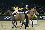 Team DASH rider Clarissa Lyra of Hong Kong riding Chardonay Haras des Barrages and jockey Vincent Ho of China riding Fiona D'Ecaussinnes compete in the HKJC Race Of The Riders during the Longines Masters of Hong Kong at the Asia World Expo on 09 February 2018, in Hong Kong, Hong Kong. Photo by Diego Gonzalez / Power Sport Images