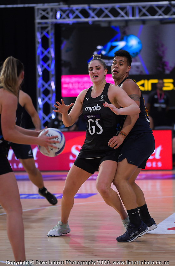 Silver Ferns goalshoot Te Paea Selby-Rickit and NZ Men's goal defence Jake Schuster in action during the Cadbury Netball Series final between NZ Silver Ferns and NZ Men at the Fly Palmy Arena in Palmerston North, New Zealand on Saturday, 24 October 2020. Photo: Dave Lintott / lintottphoto.co.nz