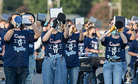 The Greenwood High School band plays the national anthem before Friday's football game against Springdale Har-Ber.